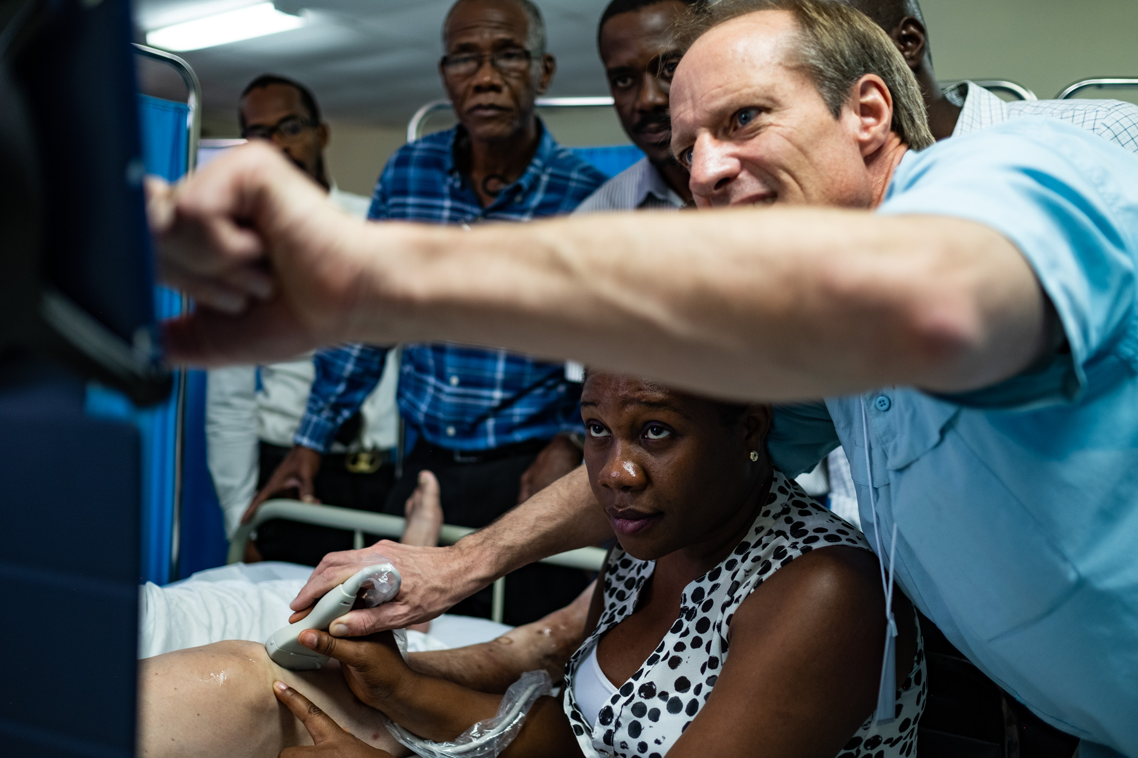 Dr. Cliff, NYAGI founder and ultrasound champion, uses 7D Imaging's mskNAV software to show a Haitian doctor what she should be looking for in a knee.