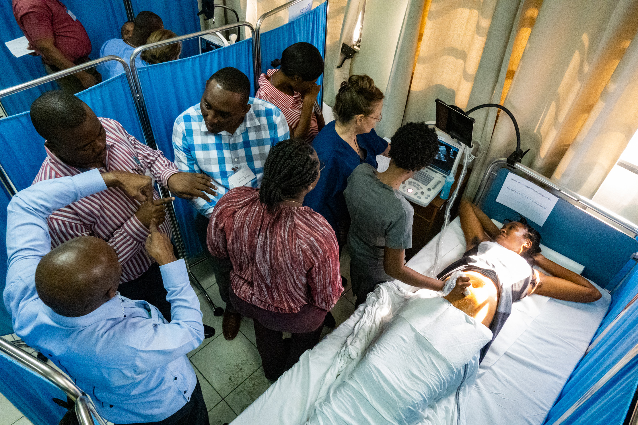 International OB/GYN, sonographer, and NYAGI veteran, Alecia Martin-Hirsel, steps aside as her group of Haitian doctors and nurses take over the probe, exploring and teaching themselves and each other.