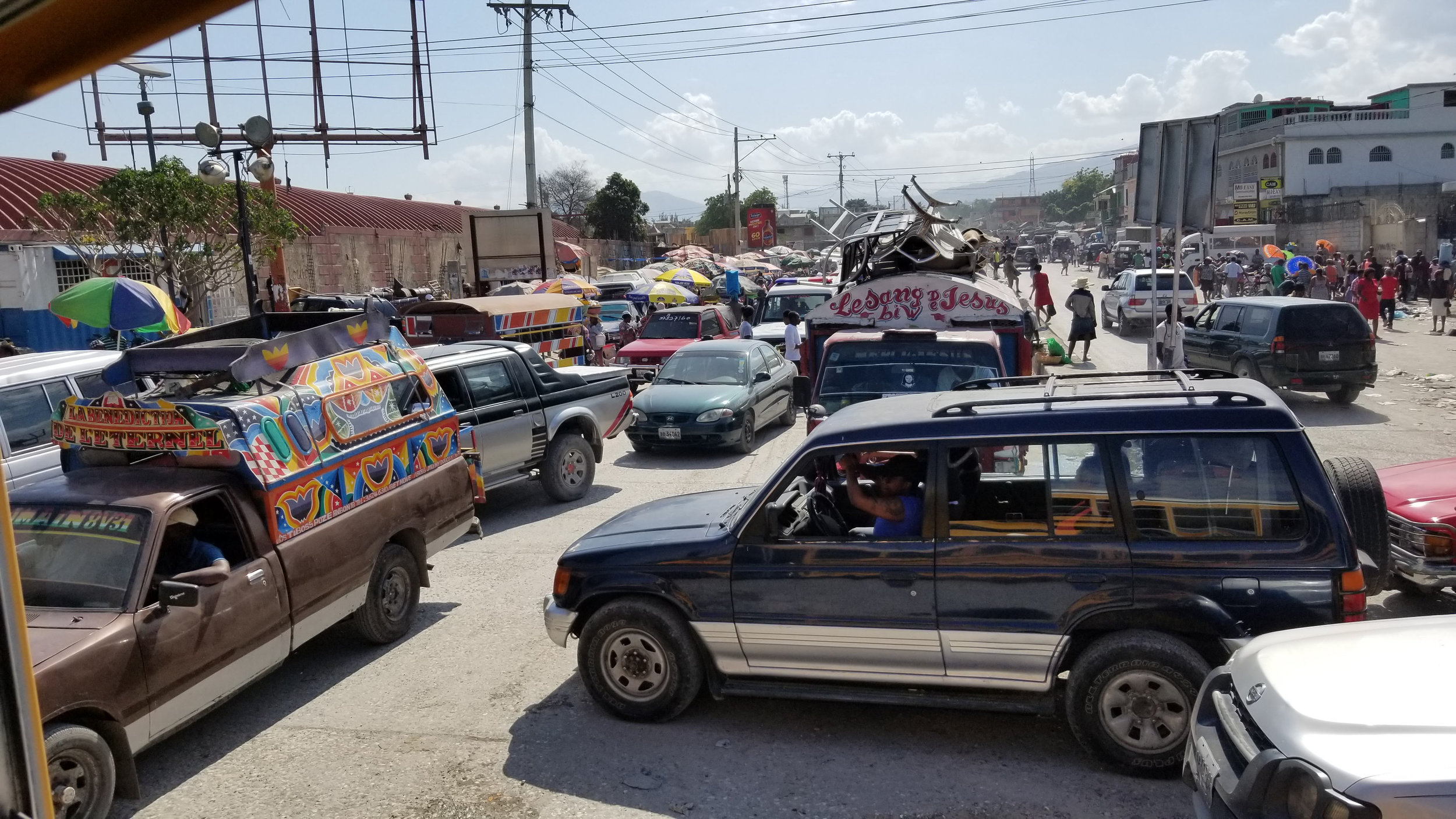 Traffic in Port-au-Prince is unbelievable in every sense of the word. Unbelievable that there can be so many cars with places to go. And unbelievable that one can actually get anywhere navigating through it all!