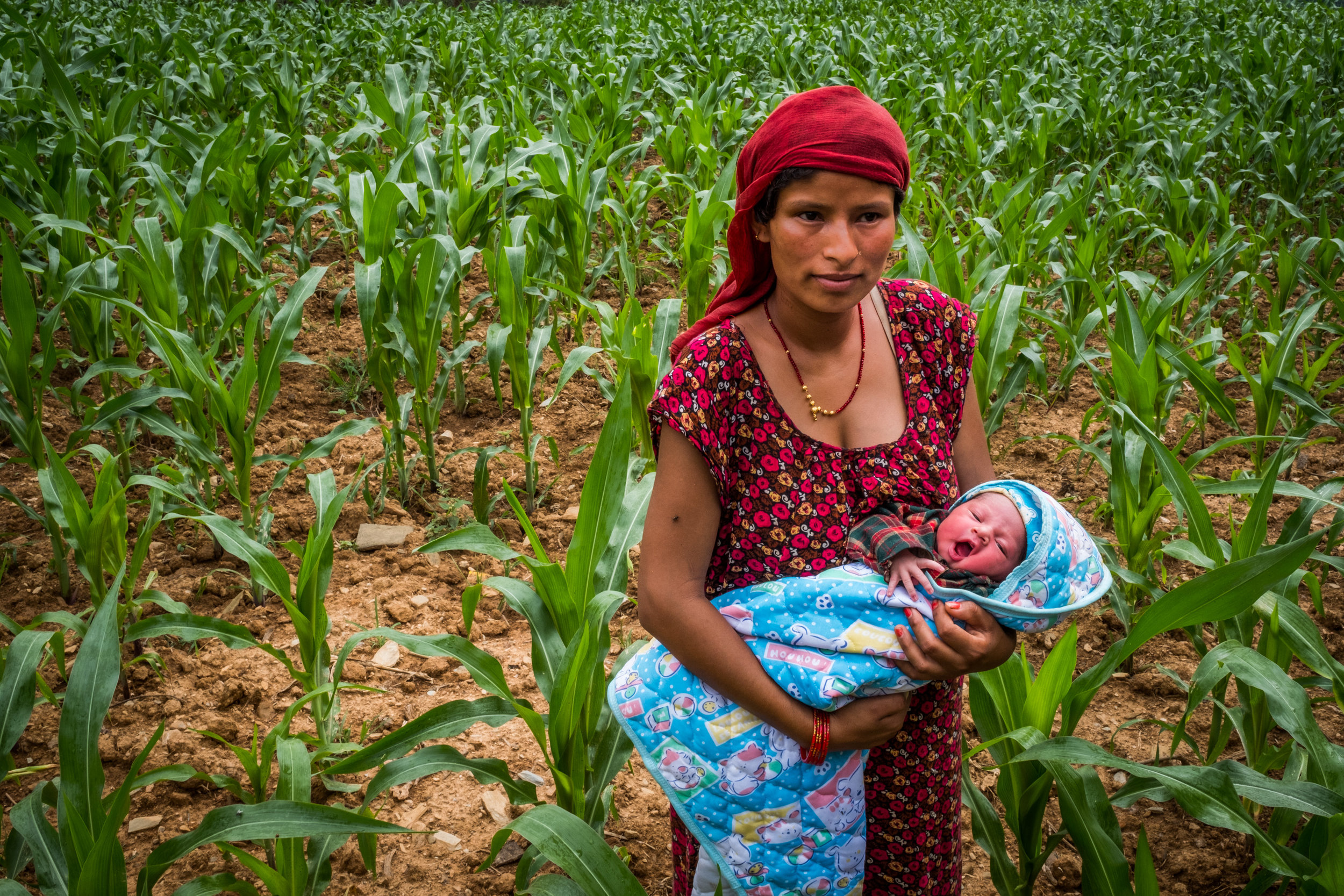 Indira Khatri, 23, with her second child. She lives is Thokarpa, Nepal an hour's walk from a small clinic and 4-5 hours drive on rough dirt roads from the nearest advanced medical facility.