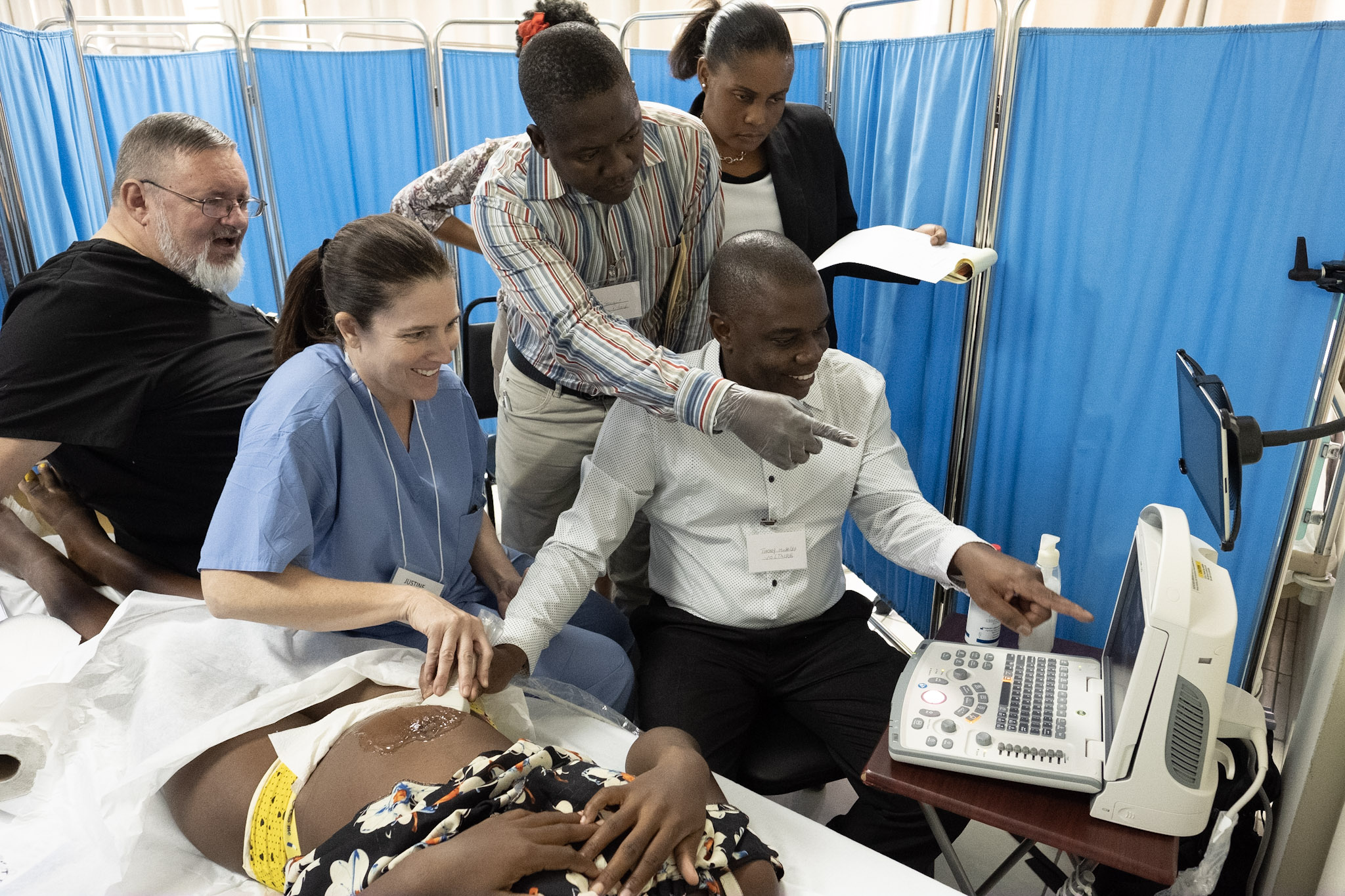 NYAGI Instructor Justine Campbell working with local Haitian providers.