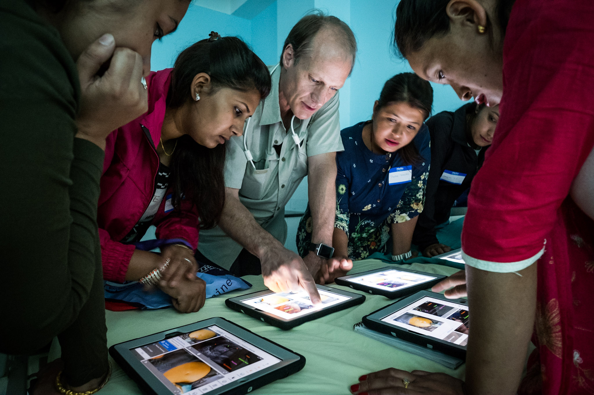 Dr. Gronseth introduces Nepalese midwives to the obNAV educational software.