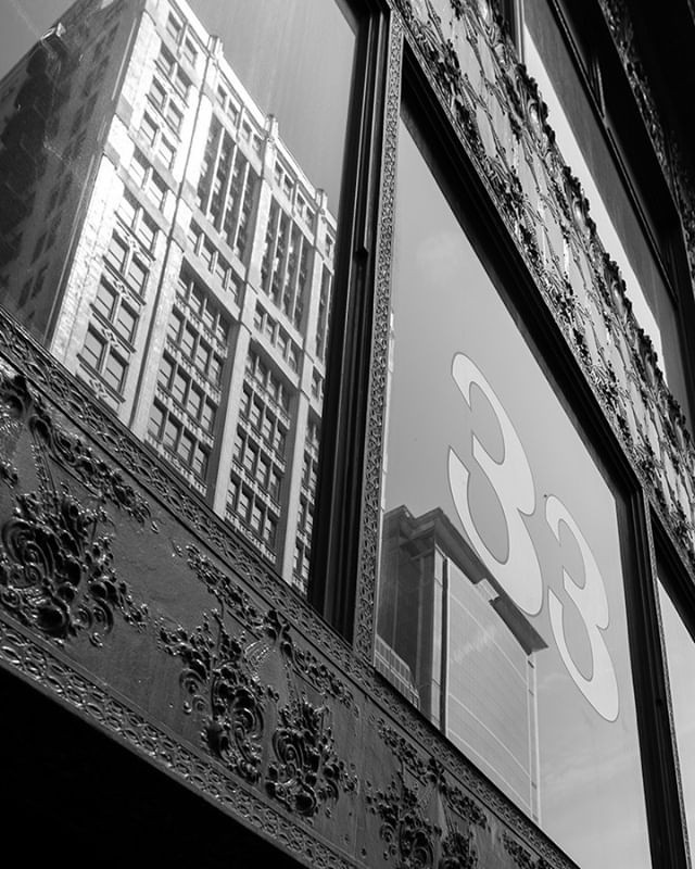Jay-Z may have given you 22, 2s, but I'll give you 3, 3s. (Spoiler alert, the 3rd 3 is me)  Another photo from my excursion with @outofchicago; this was after our tour of the Chicago theater. (I still have to edit those photos)   #blackandwhite #photo #blackwhite #snapshot #monochromephotography #cityscapes #cityscape #architecture_view #architectureporn #blackandwhitepic #chicago #33  #travelphotography #cityview #bavaria #citytrip #beautifulcity #citytour