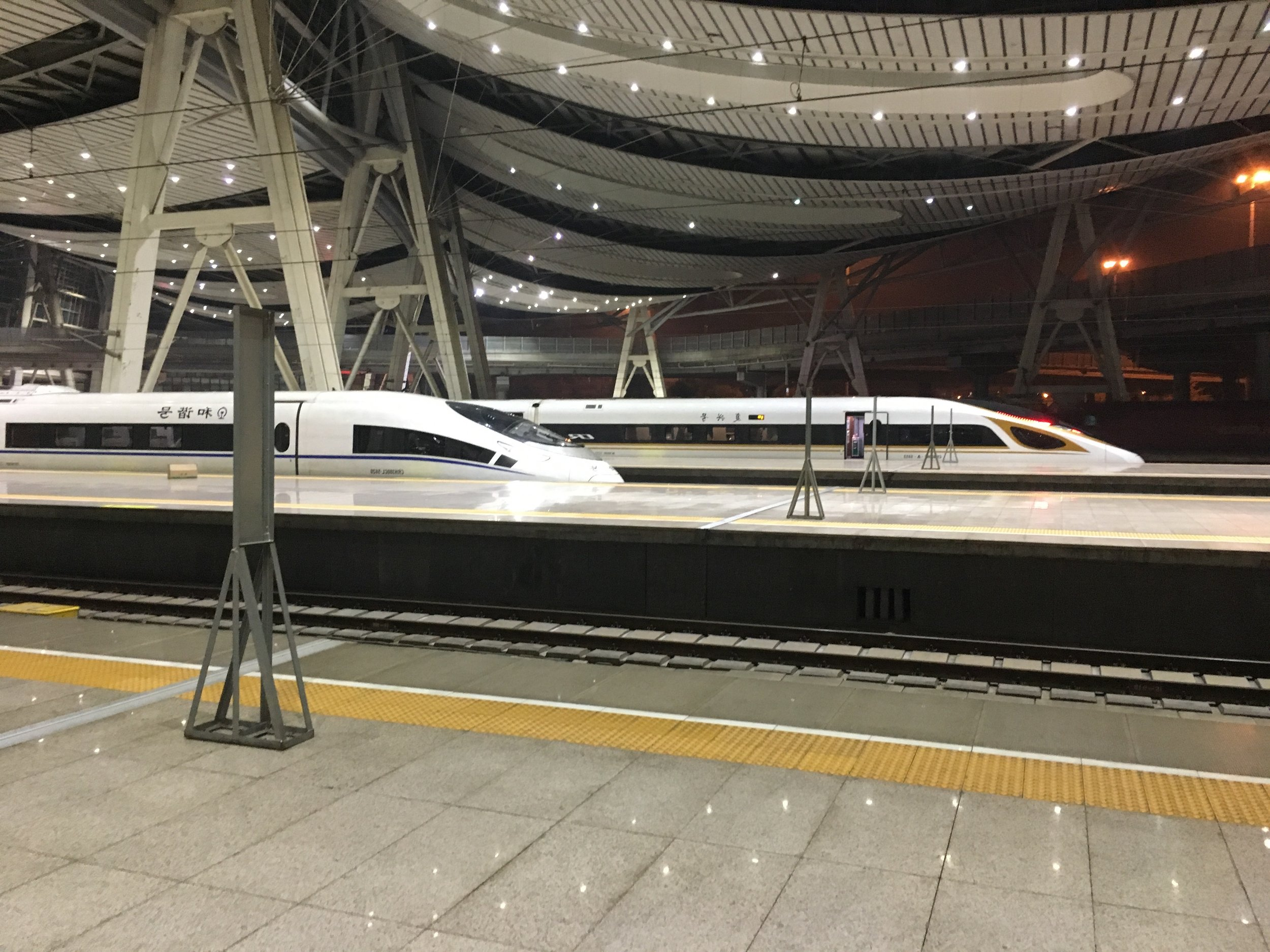 …with impressive High Speed Trains… - In just 10 years China has built 25.000+ kilometers of high speed rail networks with trains which are always on time and even come with flat bed seats.