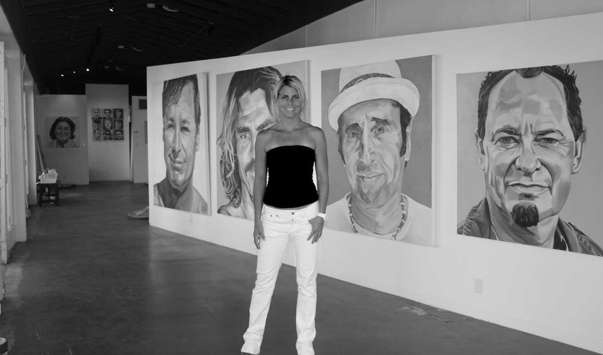Letty Nowak with her Faces of Surfing exhibit at the Lemonade Stand Gallery.