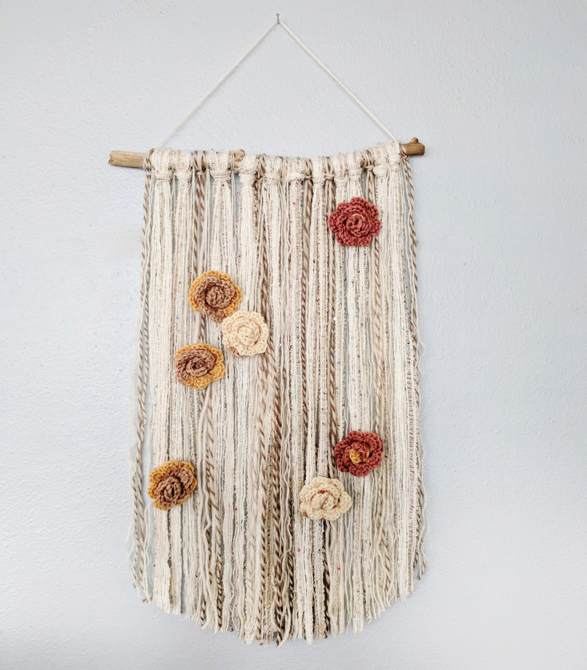 wall-hanging-with-yarn-crocheted-flowers.jpg