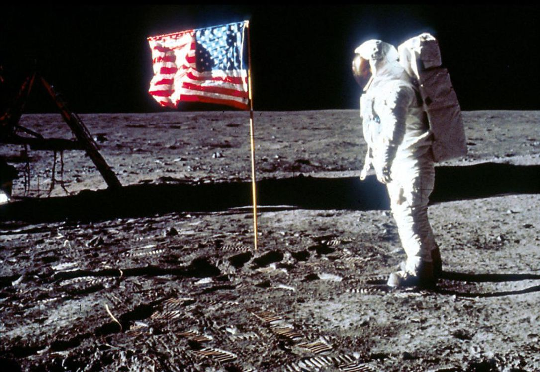 Buzz Aldrin, the second man to walk on the moon, salutes the Stars and Strips
