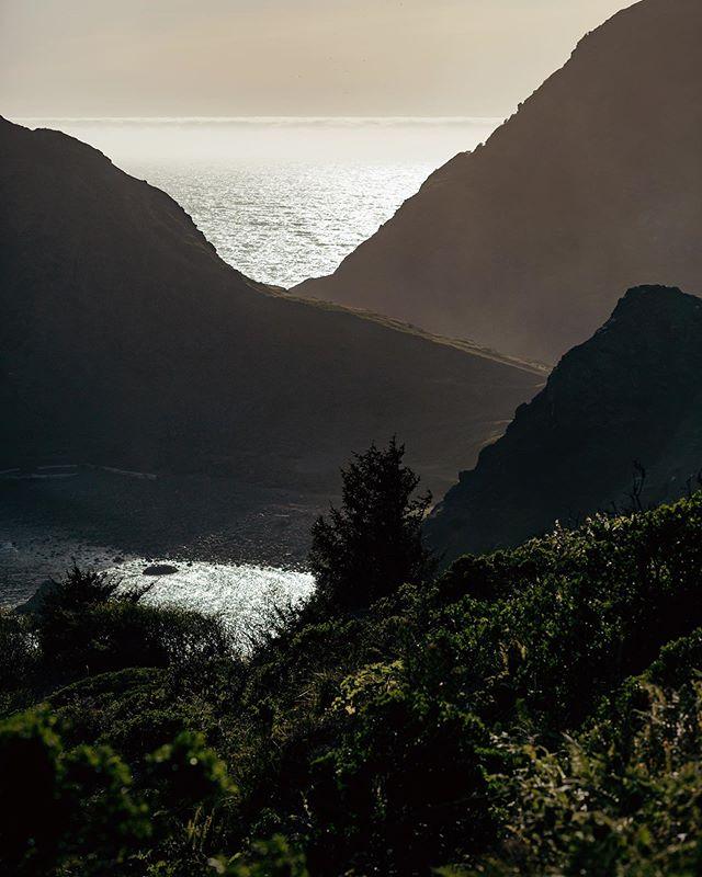 the sun hitting Sisters Rocks.  Oregon coast.
