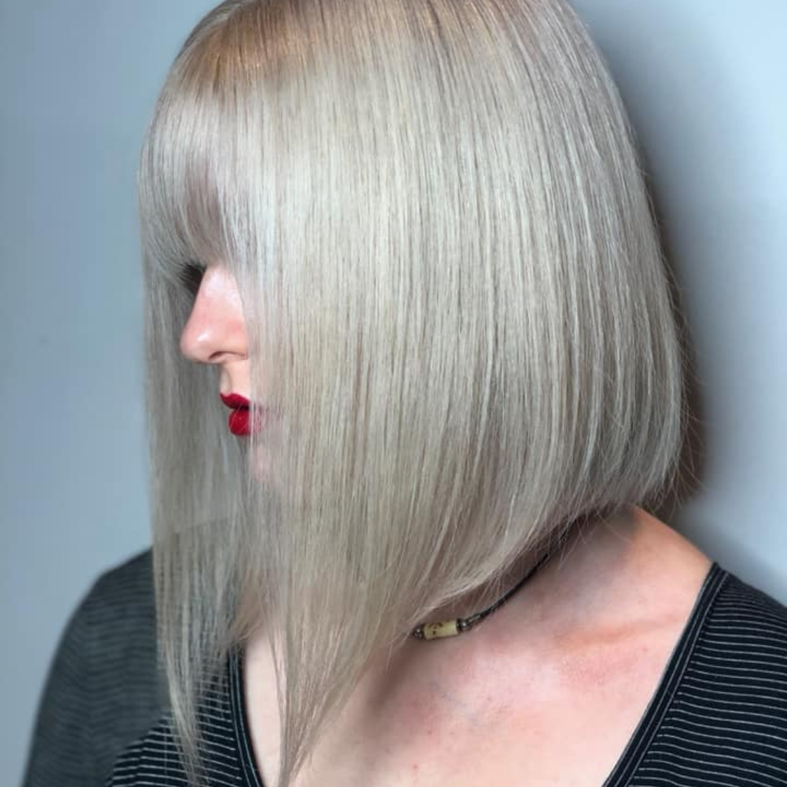 Rebecca Crosby Stylist Artistik Edge Hair Salon Lake Highlands Texas blonde bob.png