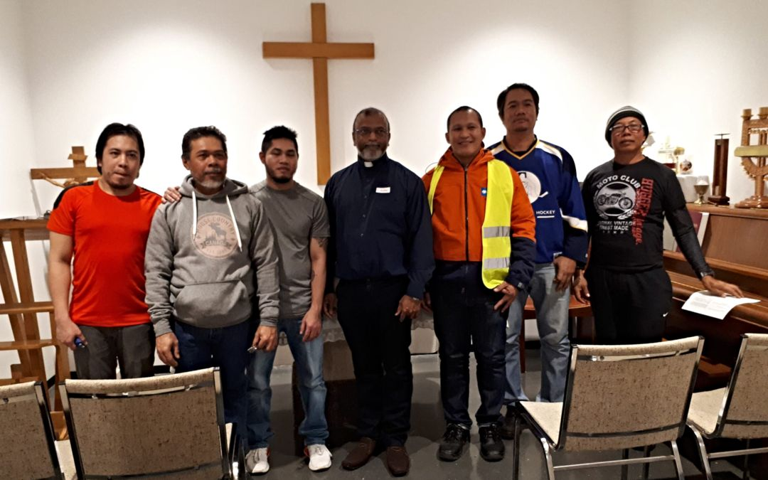 Seafarers attending a Catholic service in the Mariners' House chapel.