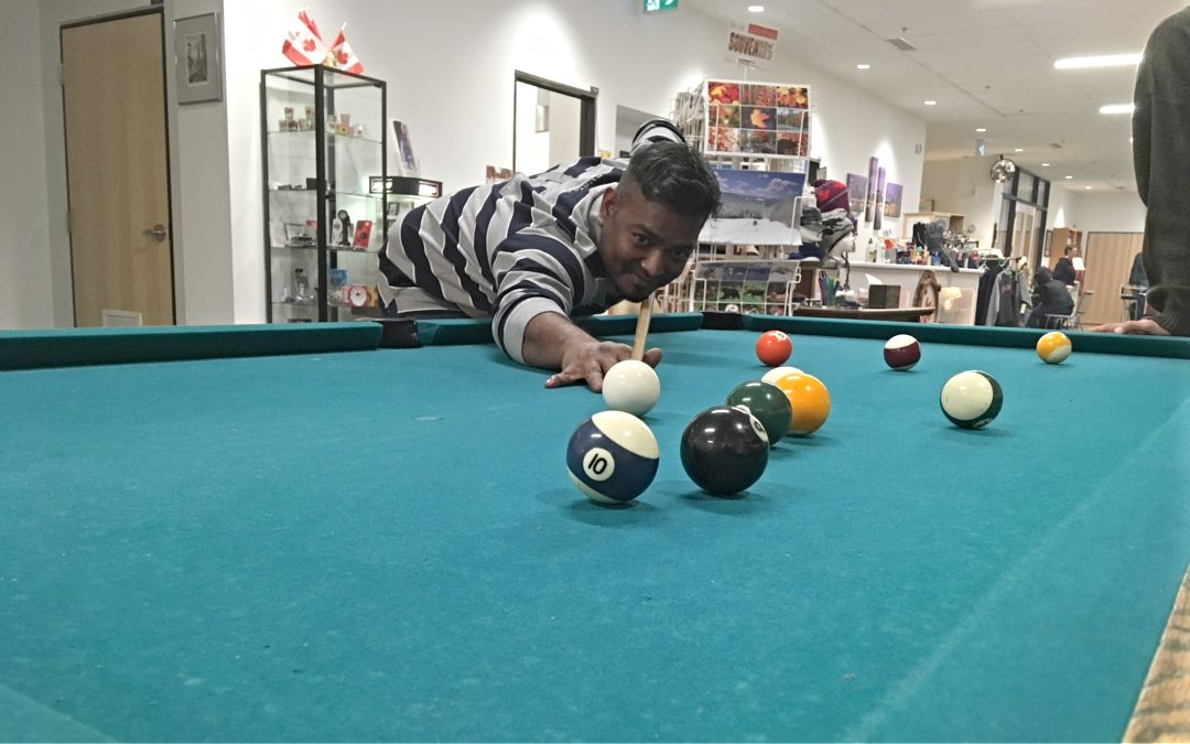 Relaxing with a game of pool. The  Sea Chest  store is in the background.