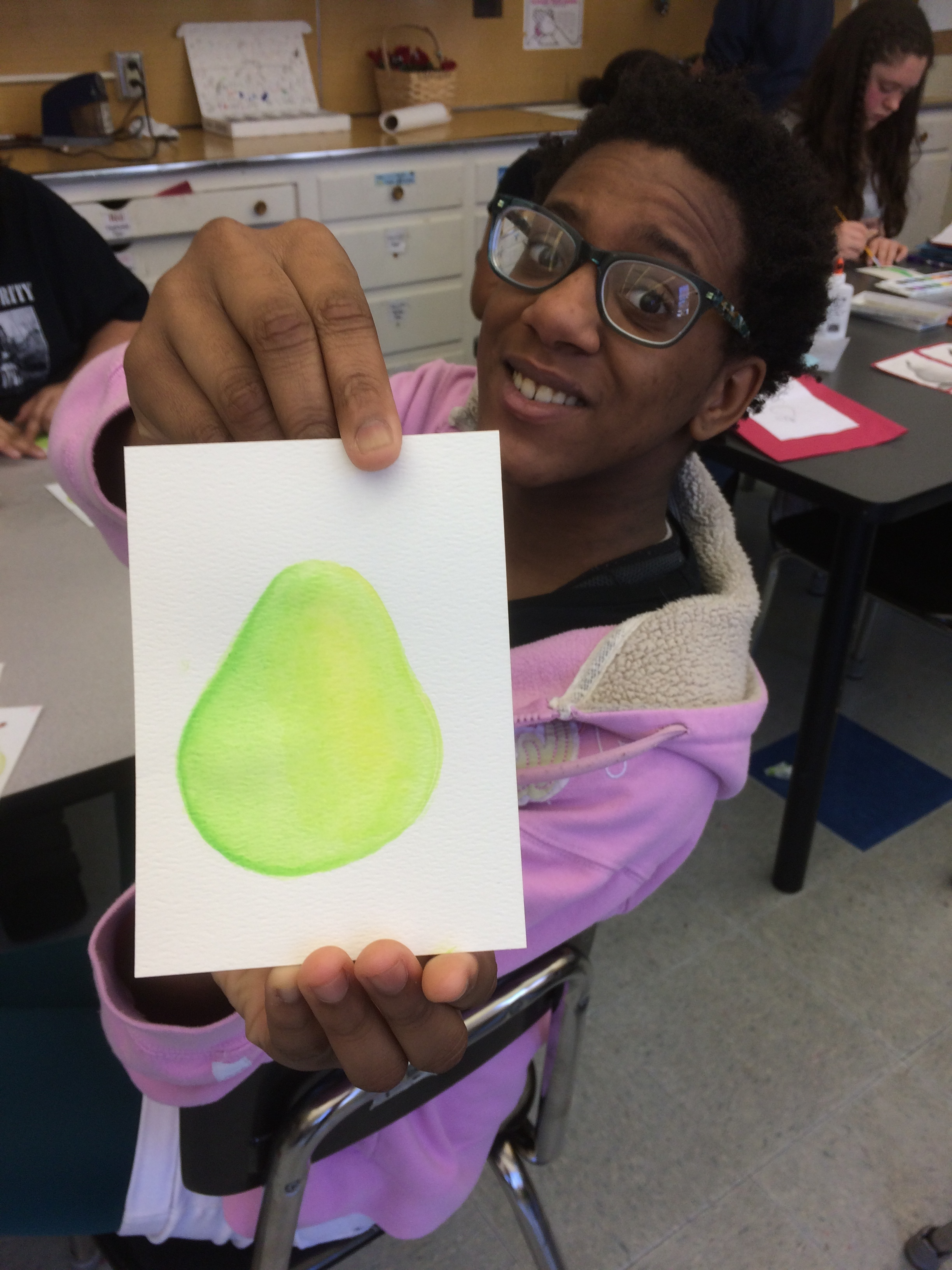 8th grader practicing shading/value with a pear drawing