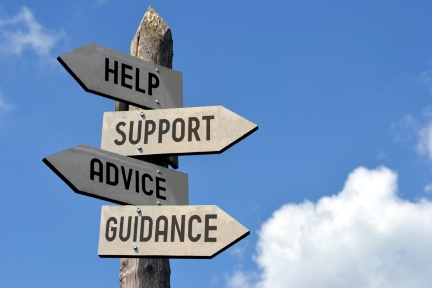 Guide signpost with different directions pointing to help, support, advice and guidance