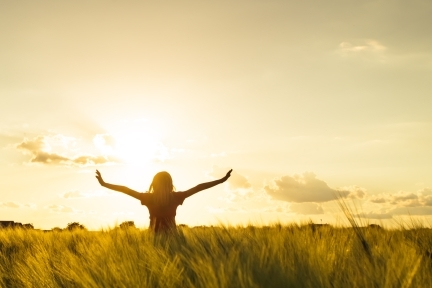 Happy Girl with outstreached arms in Field at Sunset.jpg