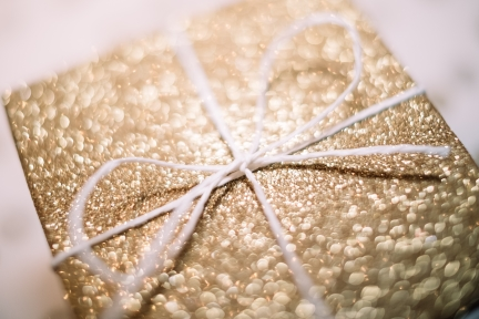 Gold Sparkly gift box with large white bow.jpg