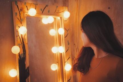 Woman looking in vanity mirror.jpg