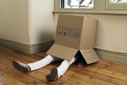 Woman with cardboard box over her head.jpg