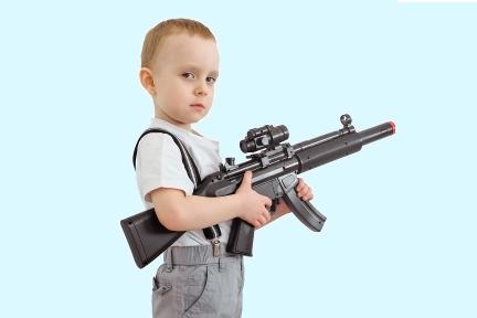 Boy with toy gun_blue background.jpg