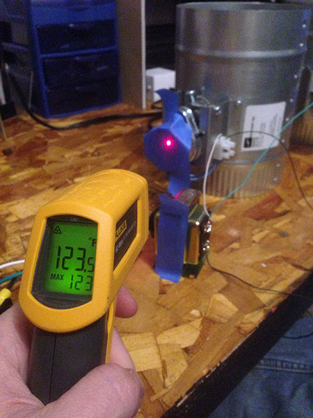 The blue tape is used to get an accurate reading from the thermometer. Otherwise the metal reflects too much and you get an inaccurate reading.