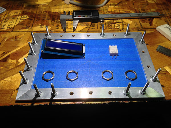 Deciding the layout on the aluminum panel for the sensor, LCD, and buttons.