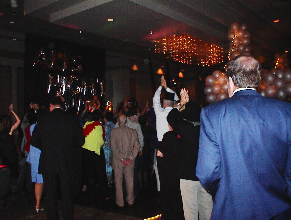 Guests dancing under the Balloon Bridge Sculpture