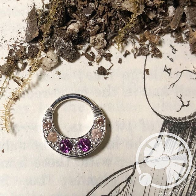 "We have some stunning options in 14k gold from BVLA that are PERFECT for fresh or healed Septum and Daith piercings. Showcased is the ""Bombay Twilight;"" a 14k white gold hinge ring featuring rhodolite, champagne sapphires and Oregon Sunstone. Next, we have the ""Alpha;"" a 14k white gold hinge ring with 1mm champagne diamonds and 3mm trillion cut champagne sapphires. Closing these lovely pieces out is a Graduating Oak Tier 14k yellow gold continuous ring, featuring smokey quartz, cubic zirconia, and champagne cubic zirconia. We have a great team of licensed and seasoned piercers here  who would be happy to assess your anatomy and see if one of these would be the ideal fit for you! @bvla #evolutionbodypiercing #settingahigherstand #bvla #14kgold #hingering #continuousring #yellowgold #rosegold #appmember #bodyjewelry"