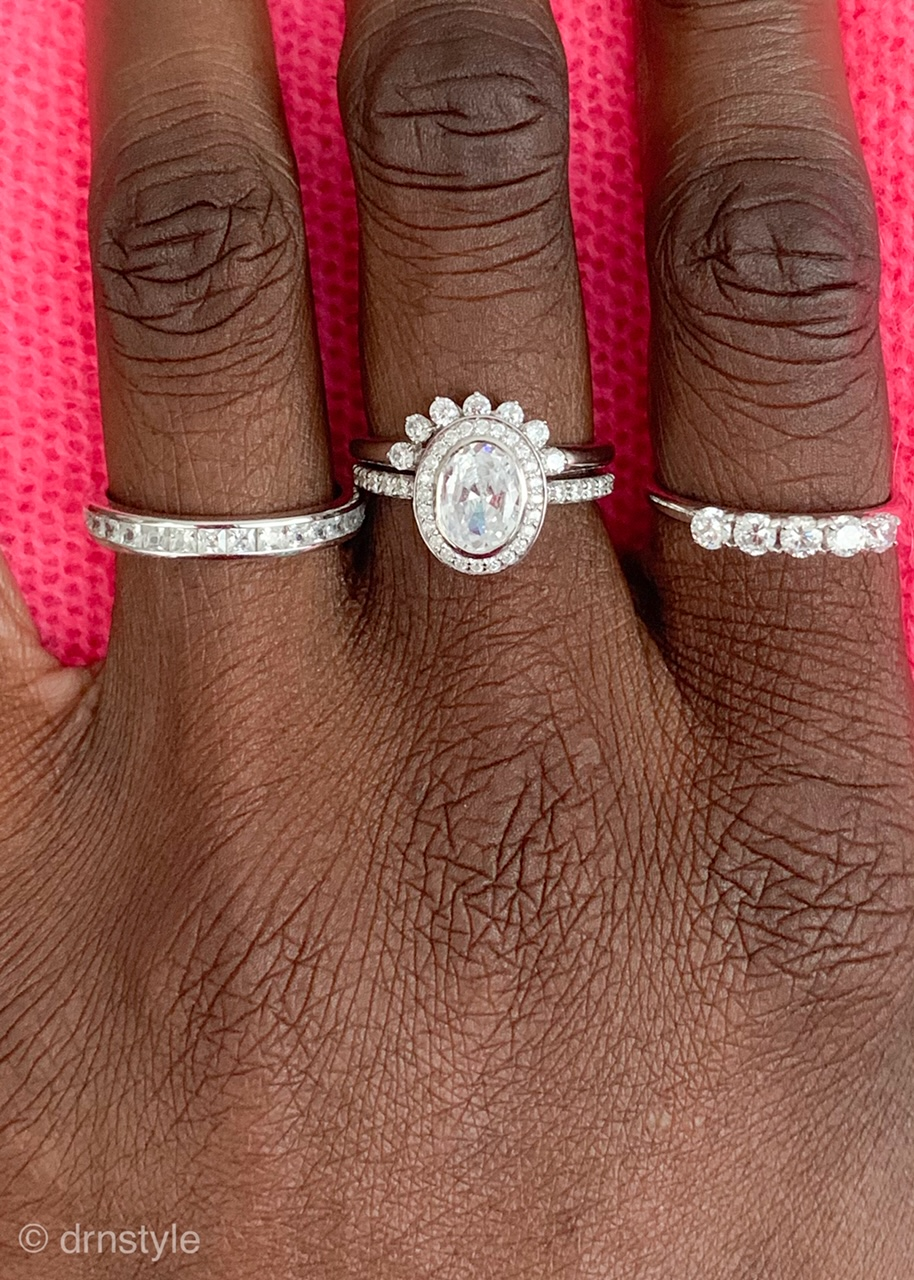 From left to right: Billie No. 3 Calibre Set Eternity Band, Harper No. 3 Halo Pave paired with the Halo Band, and Billie No. 2 Five Stone Band. All are in sterling silver with cubic zirconia stones.