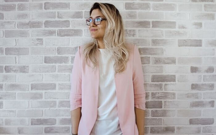 Chic style example with blonde woman wearing light pink blazer