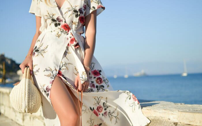 Flowing romantic style floral dress with woman on beach
