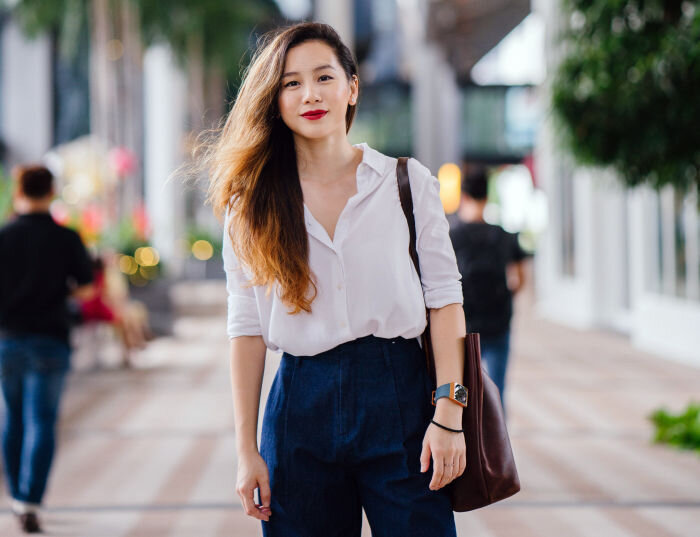 Classic preppy style wit young woman wearing white shirt