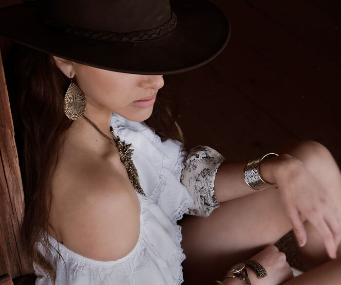 Western style fashion with woman wearing cowboy hat