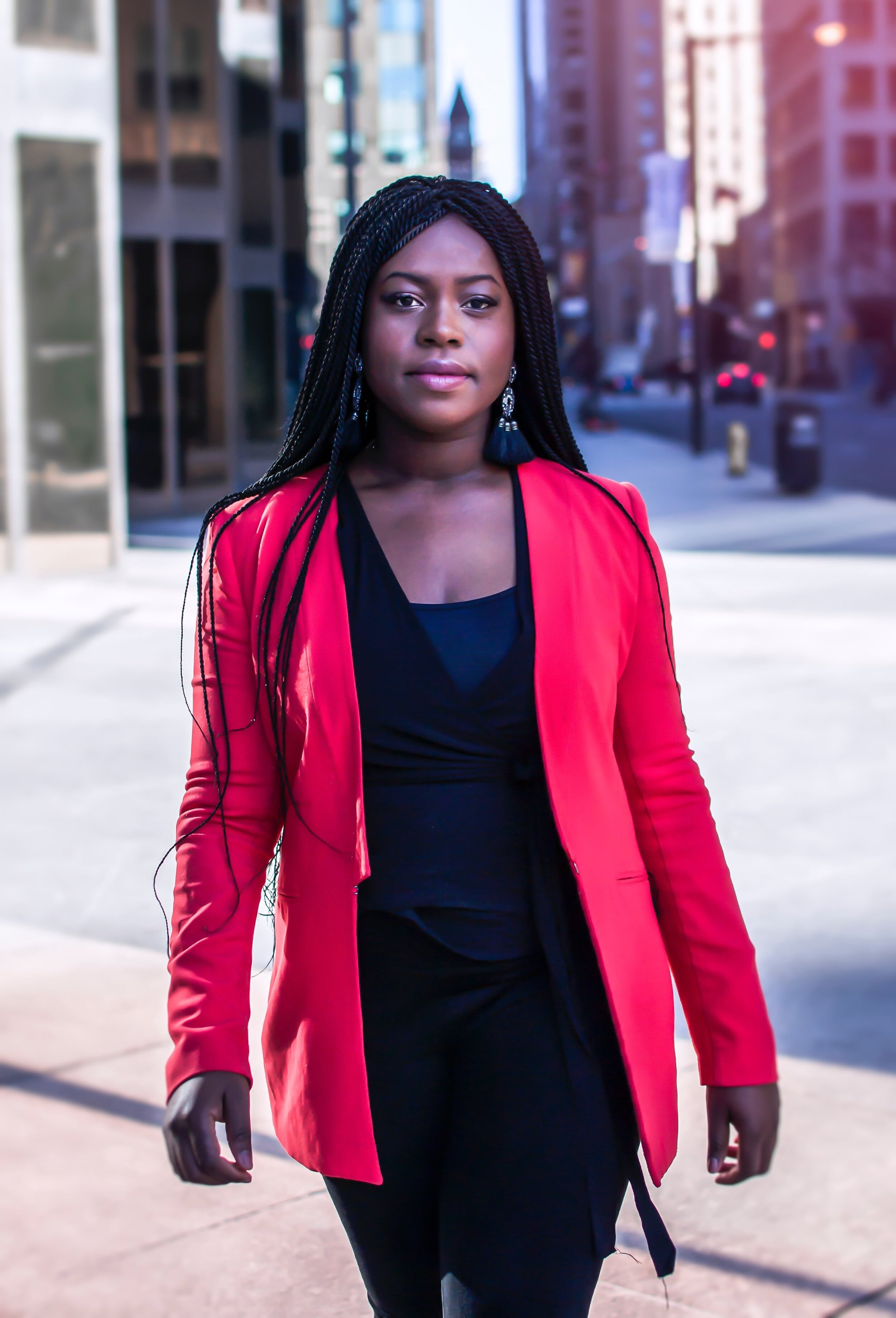 Pear shaped body type wearing bright red blazer, black wrap blouse, dark pants, best work pants for pear shaped.