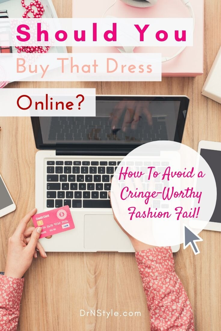 woman sitting at desk with laptop making dress purchase online with credit card.
