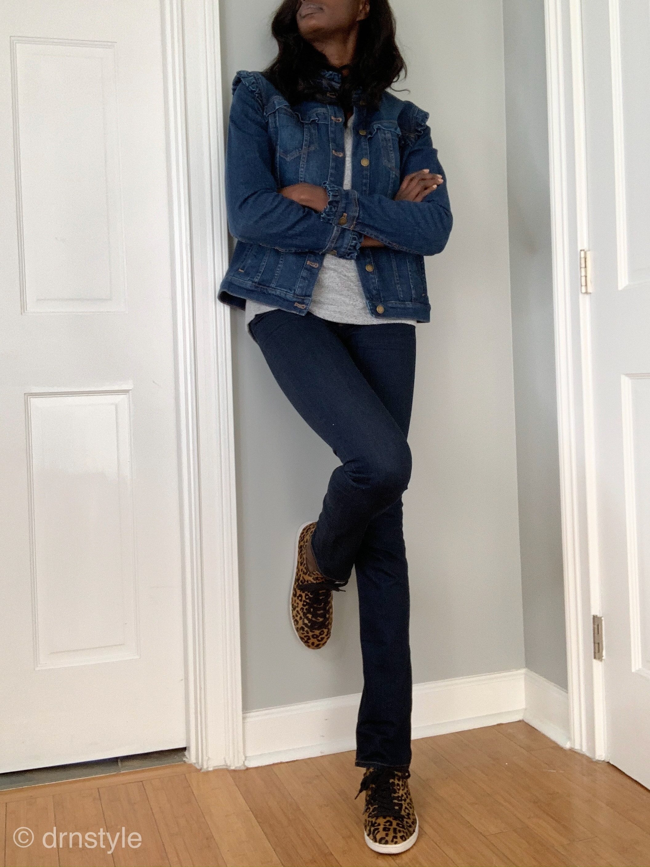 Leopard print tennis shoes with jeans, a grey t-shirt and jean jacket.