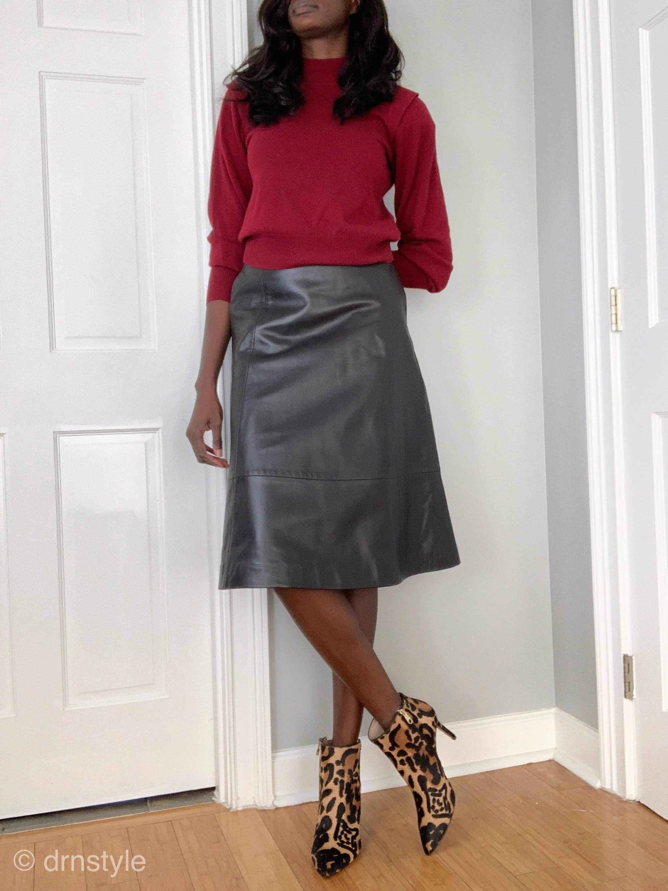 Leopard print booties can be worn with professional attire and dressed up with a sweater and leather skirt.