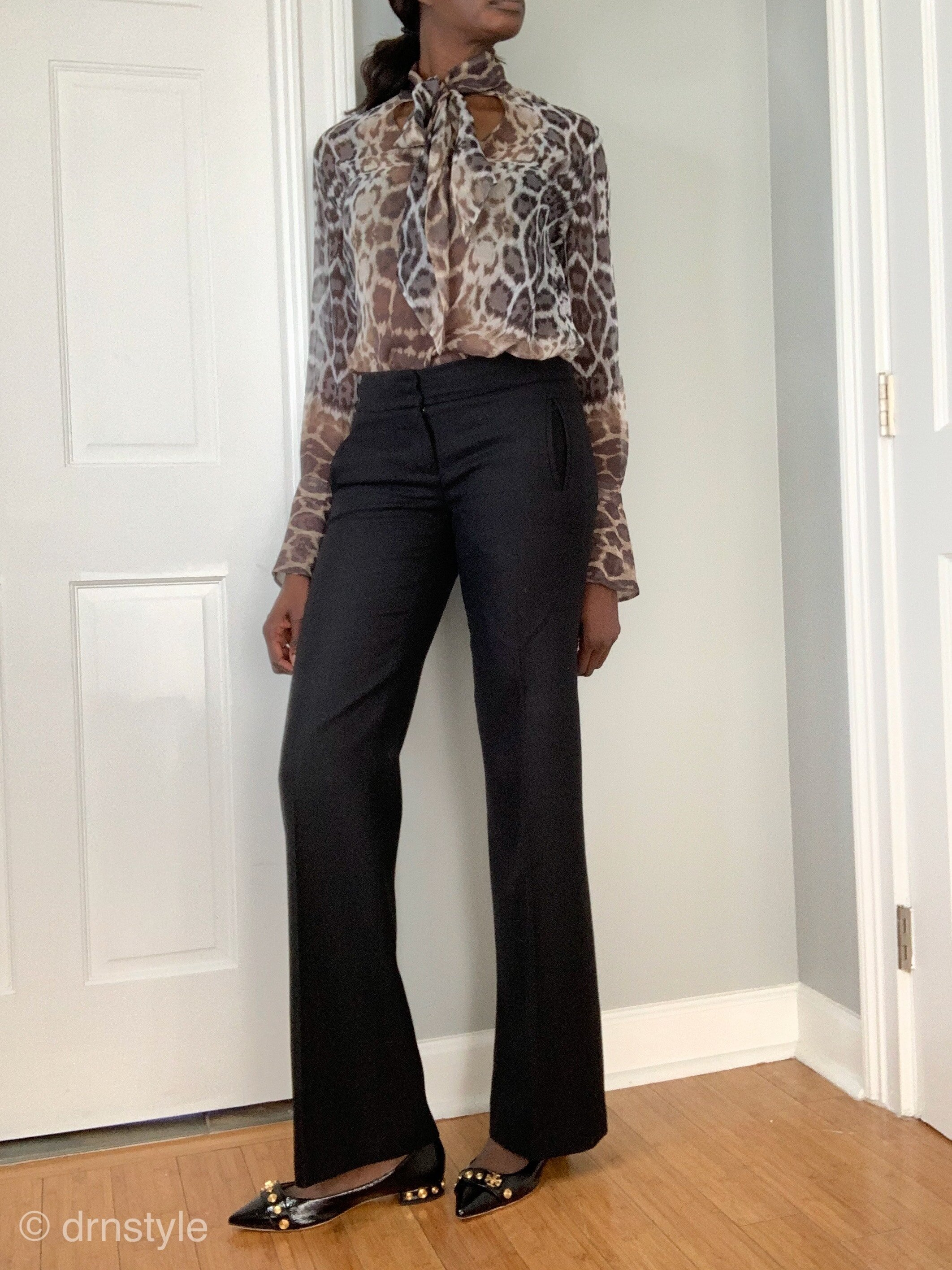 Leopard pring tops can be worn in the work environment in a tasteful, professional way.