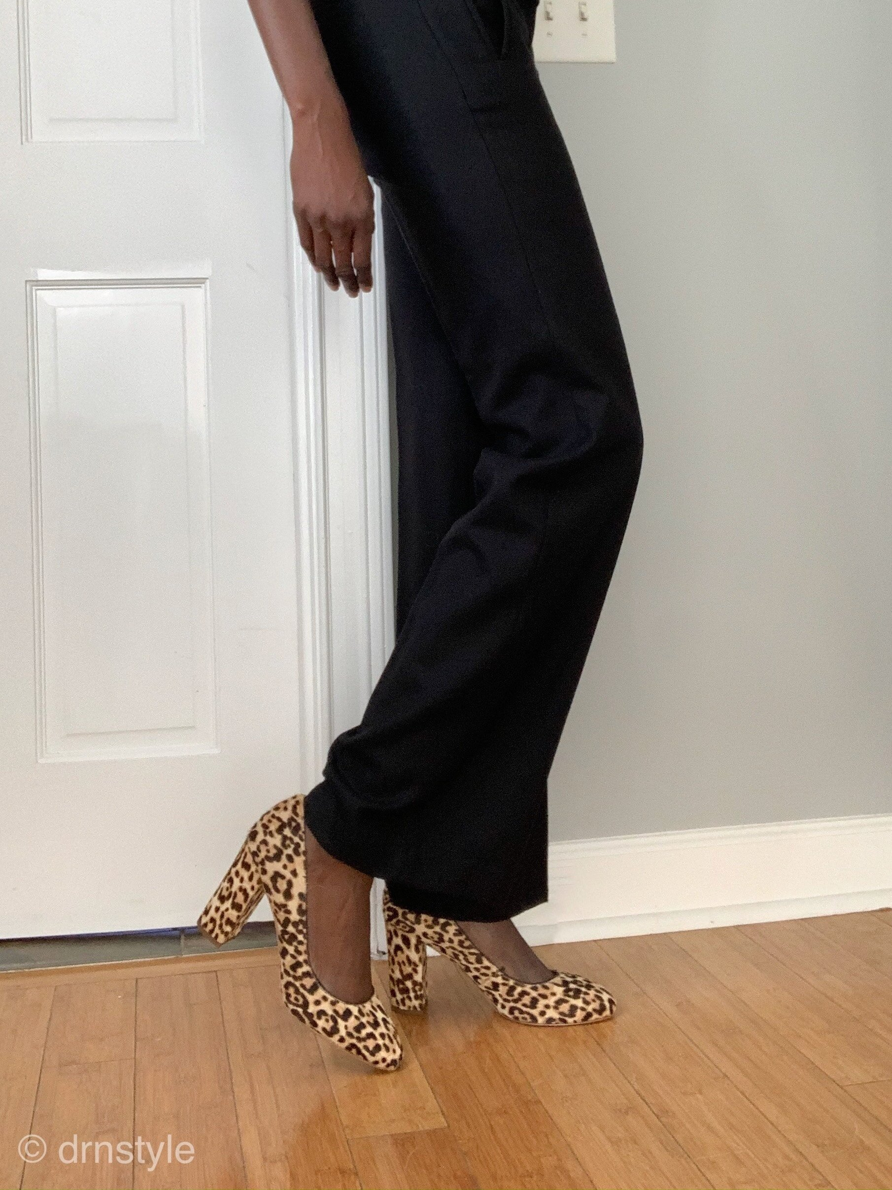 Leopard print heels give a nice splash of color to this all black ensemble.