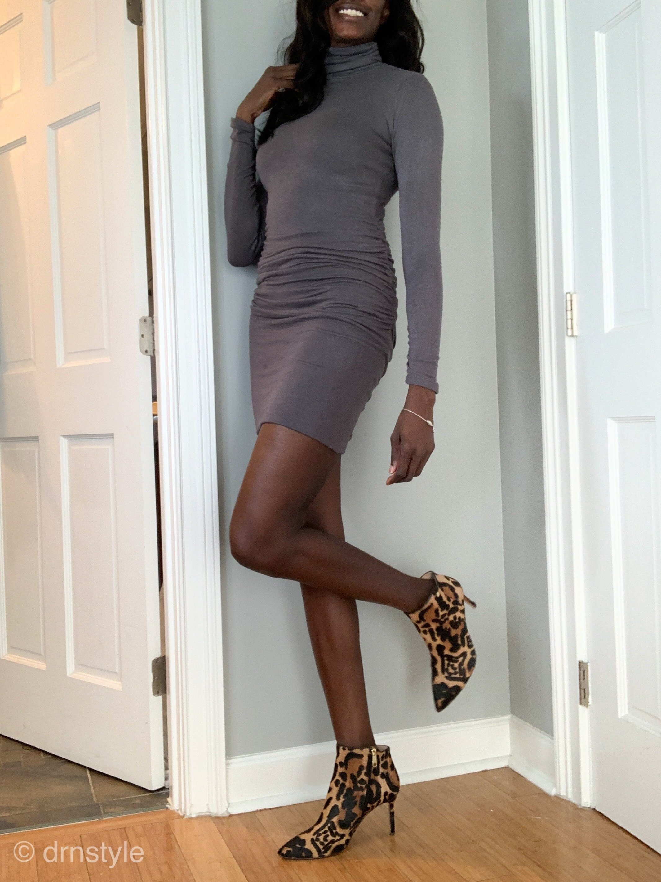 Leopard booties with a simple knee-length grey sweater dress.