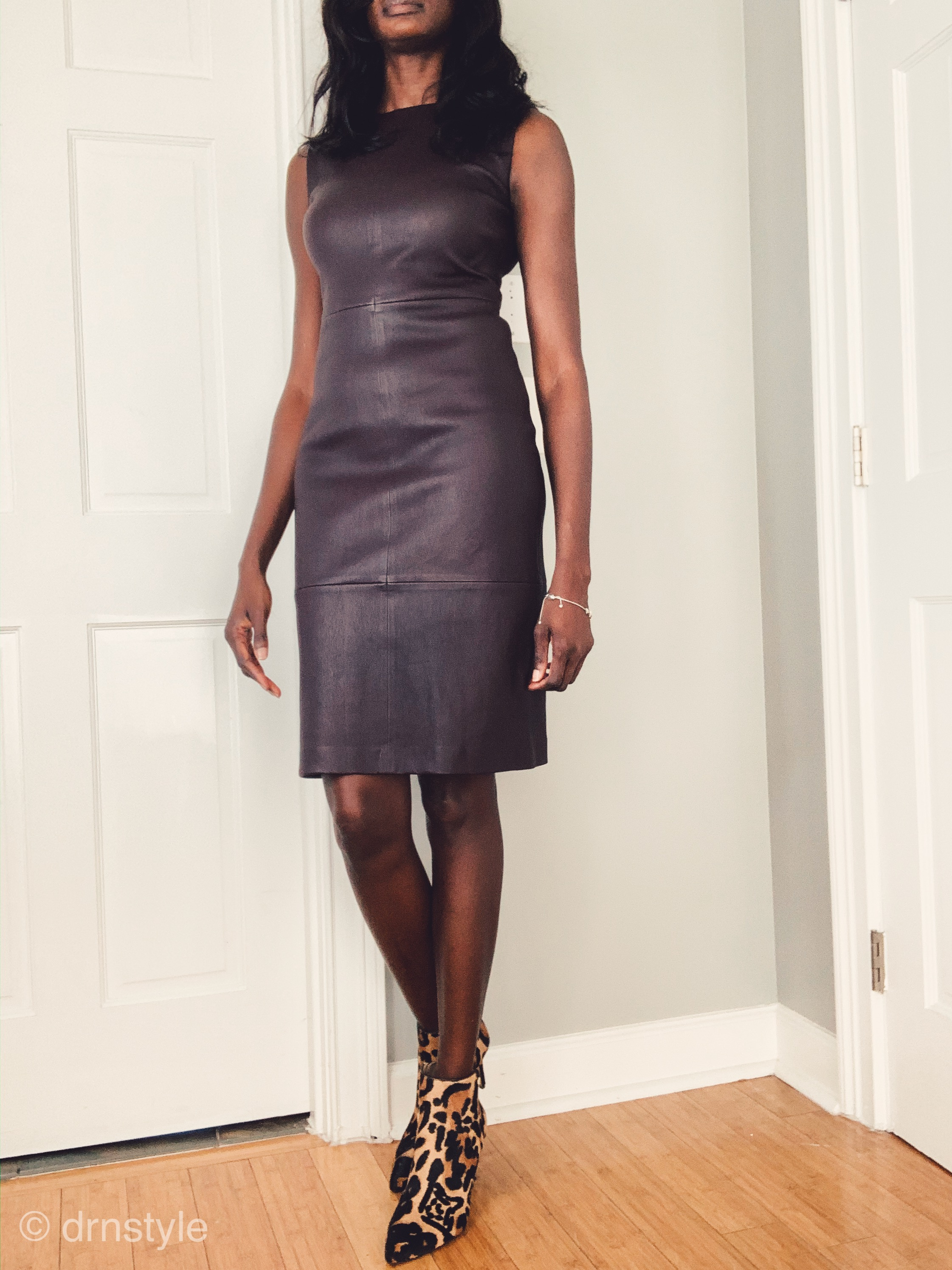 Leather dress by Vince in color dahlia wine, worn with leopard print, pointy toed ankle boots.
