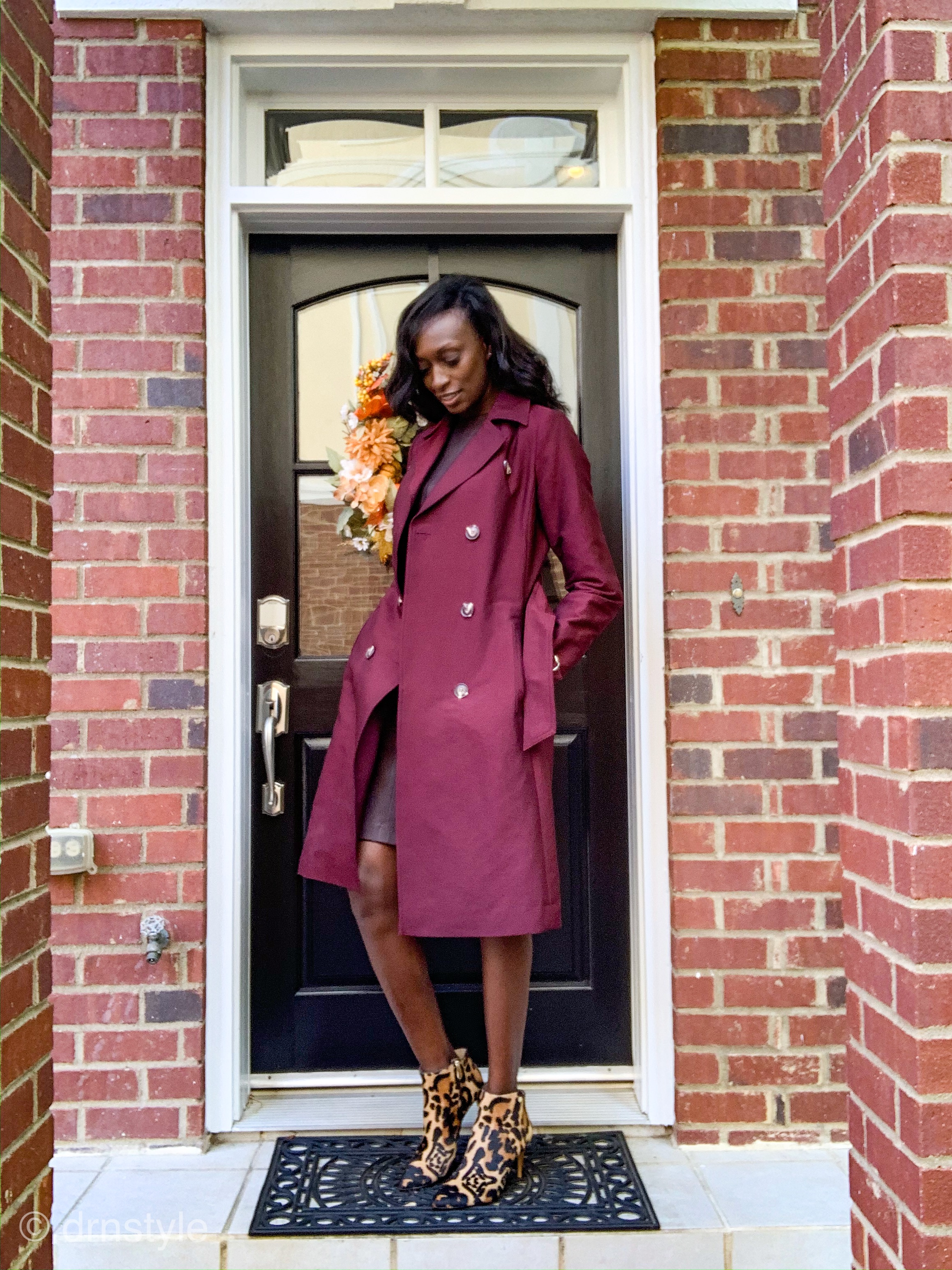 Beautiful tall woman wearing classy knee-length wine colored leather dress by Vince, chic wine trench coat by Long Tall Sally and sexy leopard print ankle boots for fall/winter style.