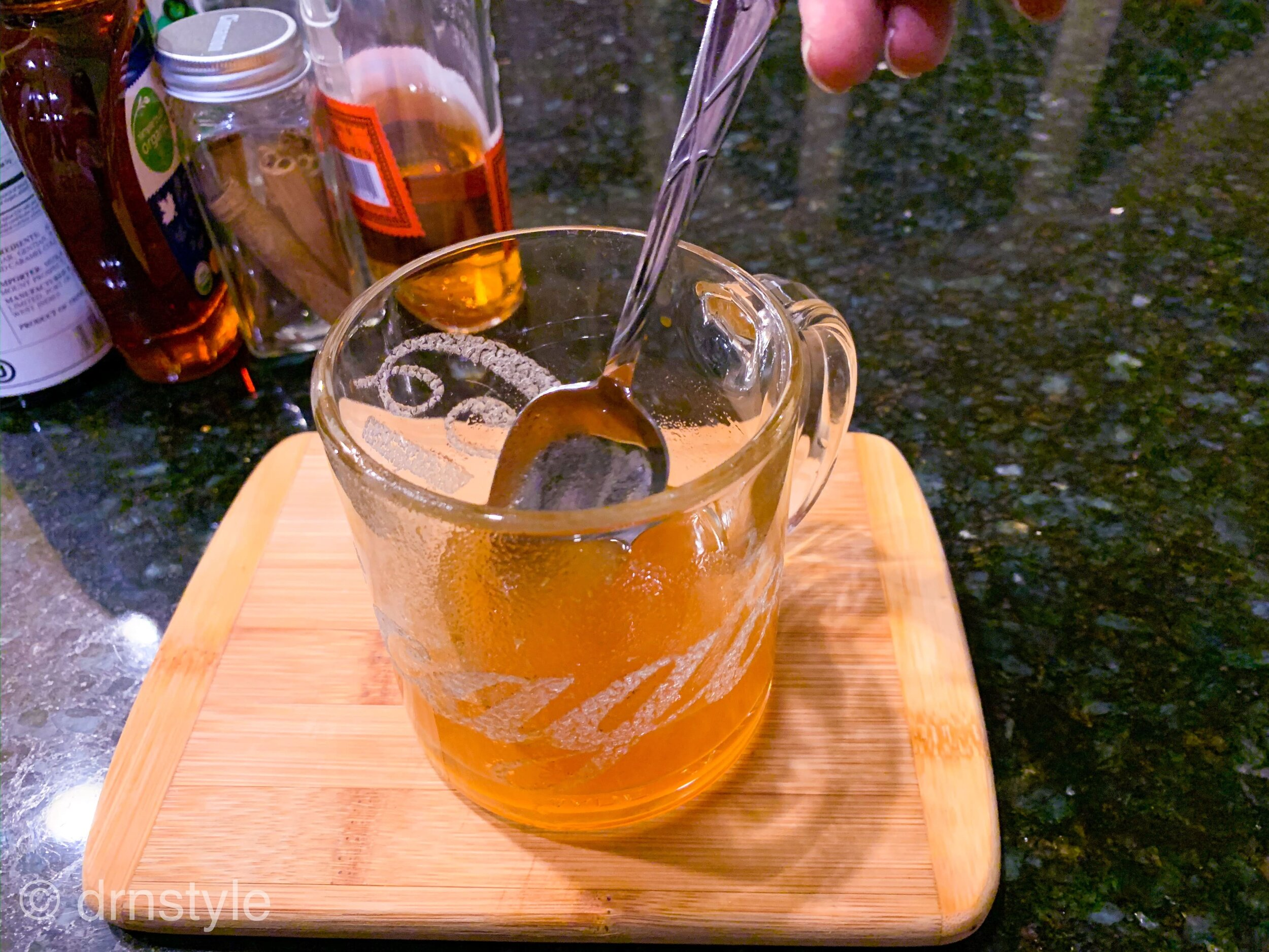 Hot toddy cocktail with whiskey, pumpkin, apple brandy, maple syrup, lemon, and cinnamon.