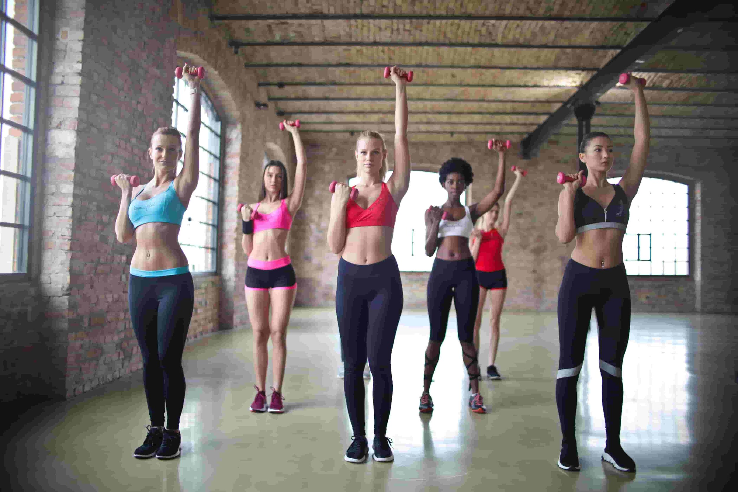 Take a group fitness class to encourage you to work out more.