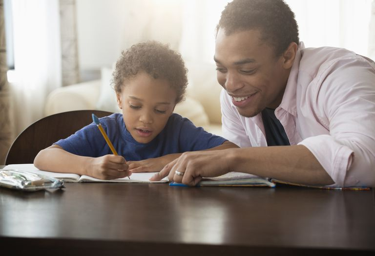 mixed-race-father-helping-son-with-homework-606355297-58b088f93df78cdcd8b1e62b.jpg
