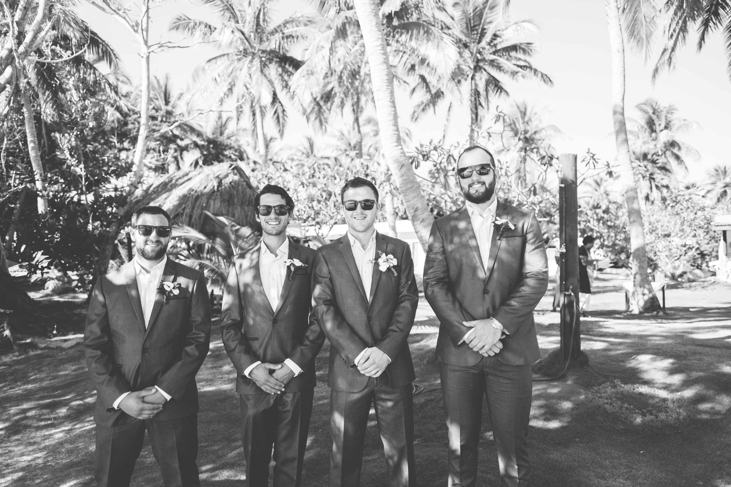 the groom with his groomsmen waiting at the ceremony venue