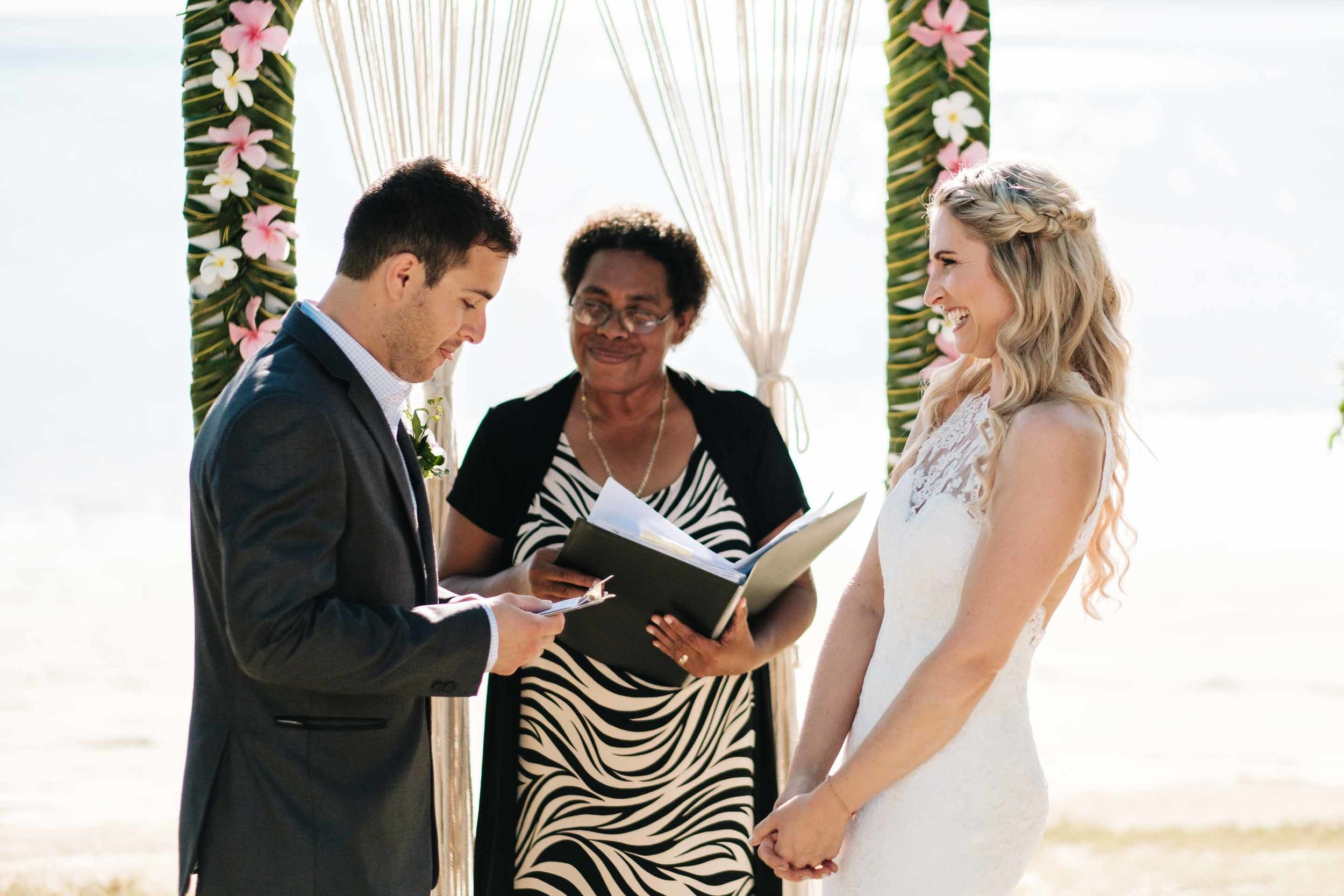 the groom reading out his wedding vows