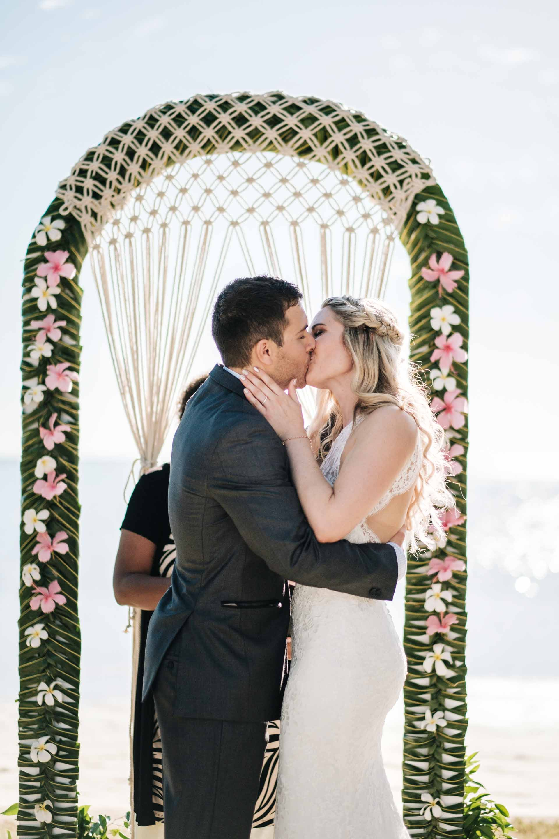 bride and groom share their first kiss as husband and wife