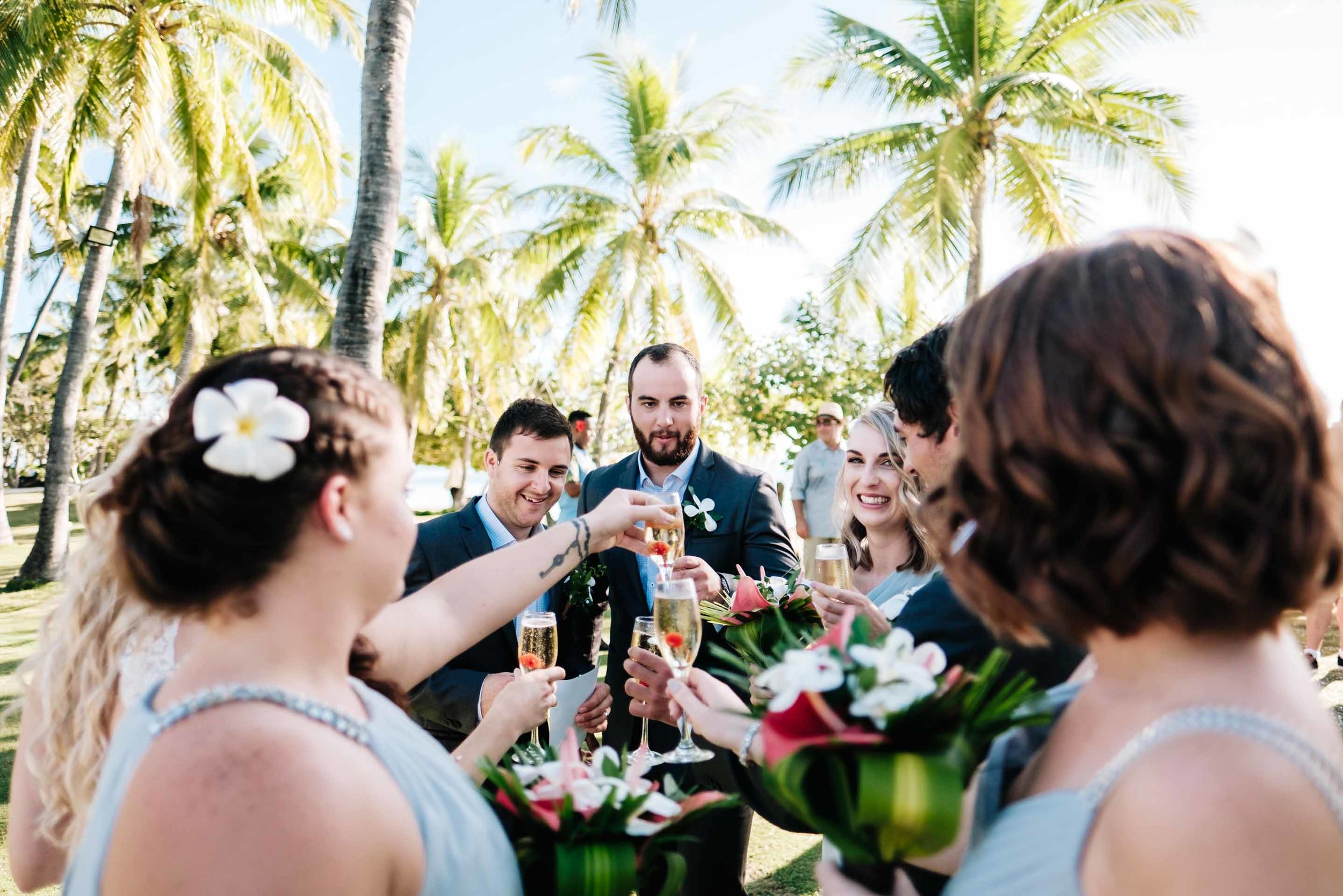 the bridal party celebrate with champagne after the ceremony