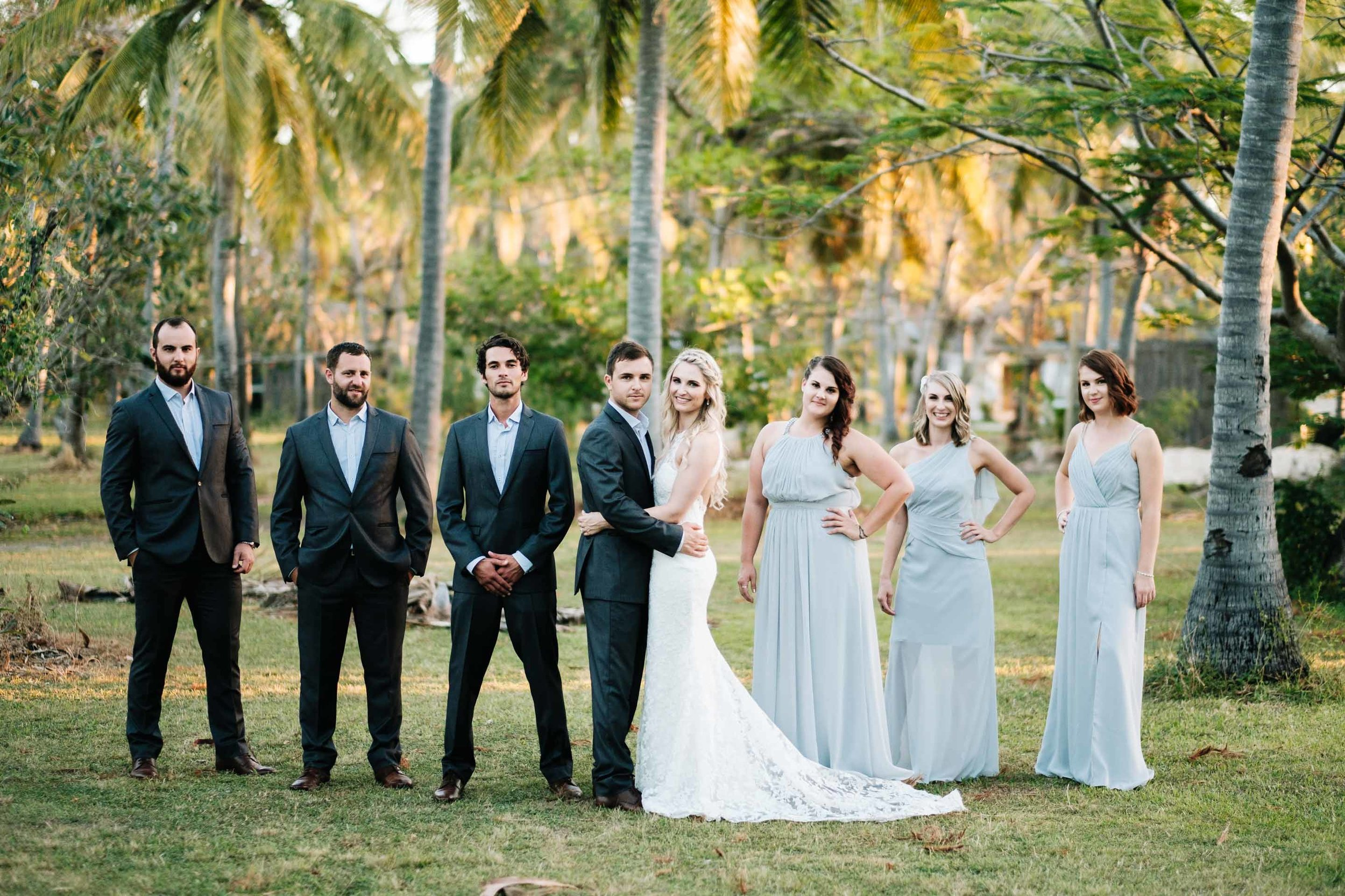 the bridal party together in the grounds behind Lomani Island Resort
