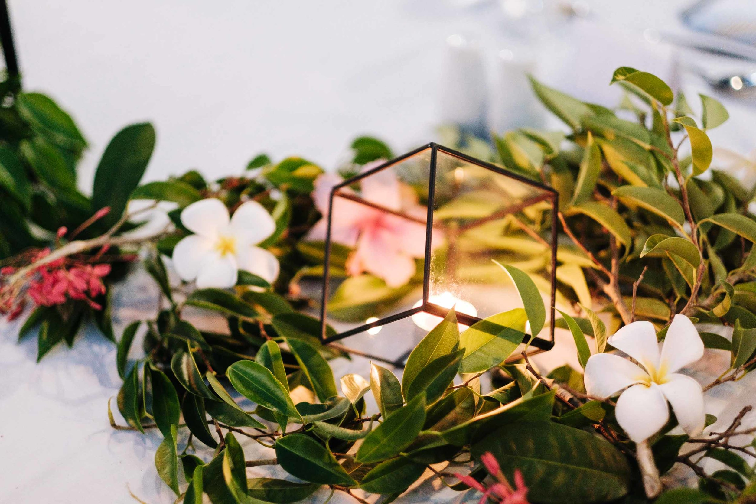 geometric candle holder between greenery as part of the bridal table setup