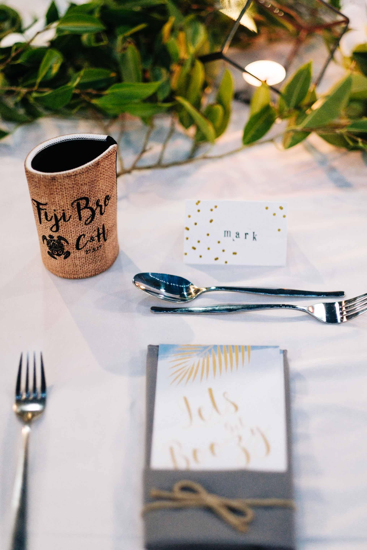 wedding reception setup with custom beer holder as a wedding favo